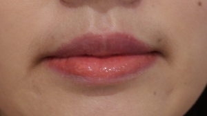 Lancôme Lip Lover Corail Cabriole on bottom half of lip